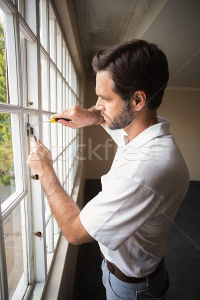 окна дома человека Сток-фото © wavebreak_media