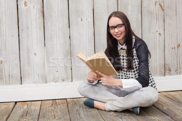 Pretty hipster reading a book Stock photo © wavebreak_media