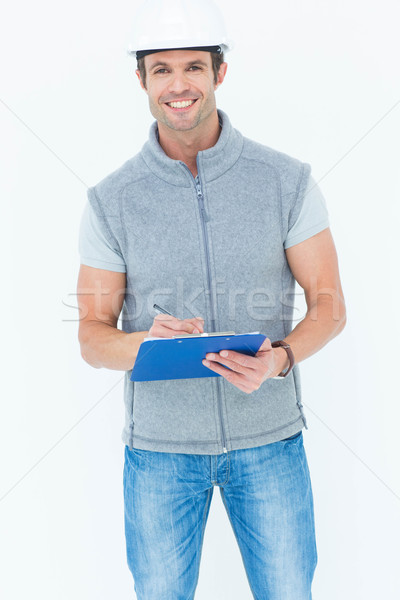 Male architect writing notes on clip board Stock photo © wavebreak_media