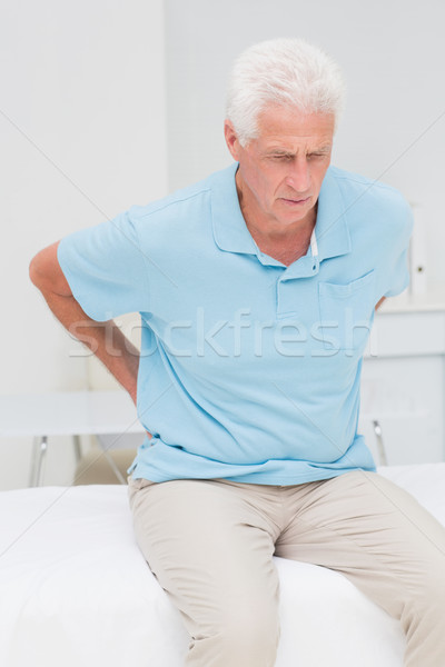 Senior patient suffering from backache Stock photo © wavebreak_media