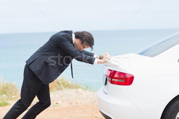 Businessman pushing his car  Stock photo © wavebreak_media