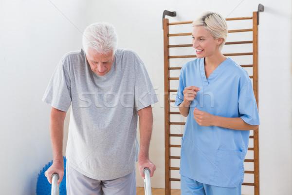 Therapist encouraging senior man  Stock photo © wavebreak_media