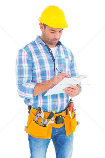 Manual trabalhador escrita clipboard branco homem Foto stock © wavebreak_media