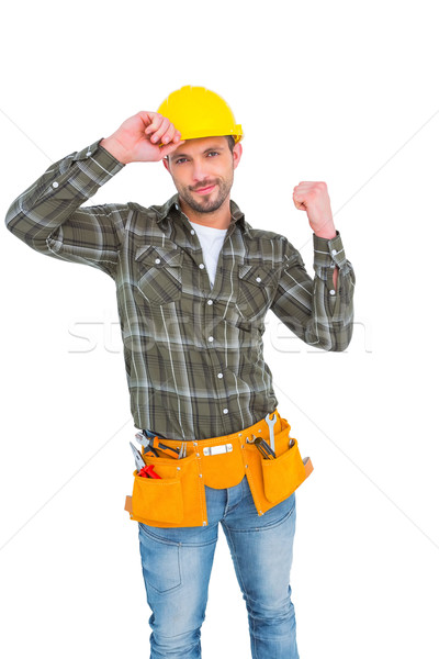 Smiling manual worker clenching fist Stock photo © wavebreak_media