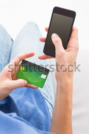 Woman doing online shopping with her mobile phone Stock photo © wavebreak_media