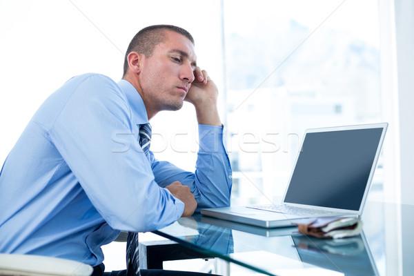 Moe zakenman naar laptop kantoor telefoon Stockfoto © wavebreak_media