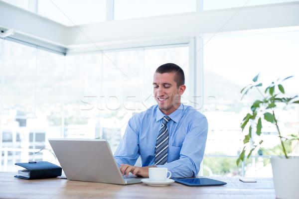 Sonriendo empresario de trabajo portátil oficina ordenador Foto stock © wavebreak_media