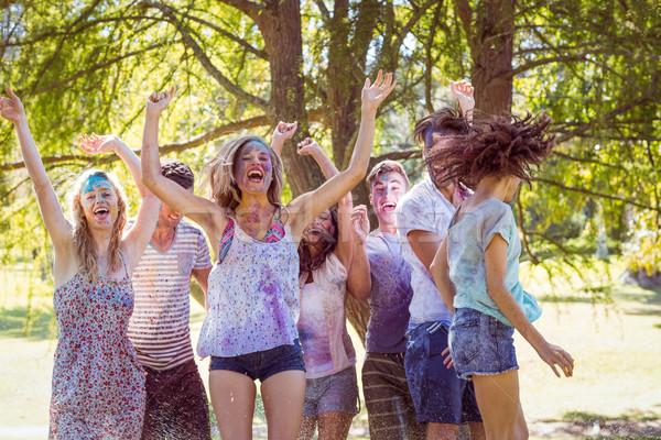 Heureux amis sautant eau femme Photo stock © wavebreak_media