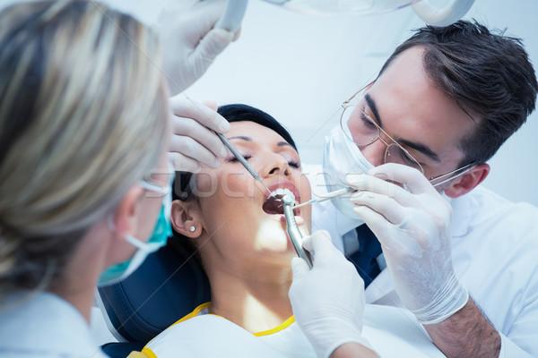 Fogorvos asszisztens megvizsgál fogak férfi fogorvosok Stock fotó © wavebreak_media