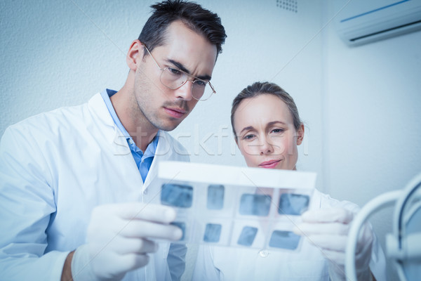 Dentists looking at x-ray Stock photo © wavebreak_media