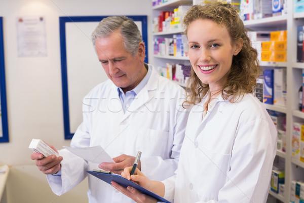 Pharmacists looking a medication for a prescription Stock photo © wavebreak_media