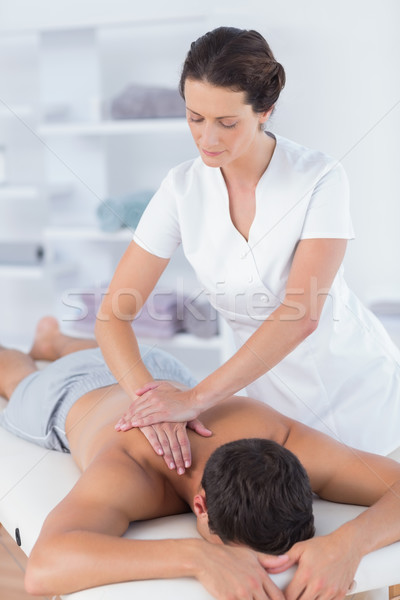 Physiotherapist doing shoulder massage to her patient Stock photo © wavebreak_media