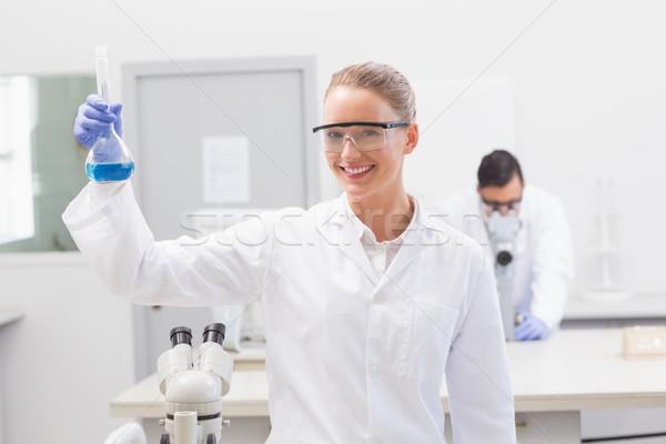 Scientist examining blue precipitate in baker  Stock photo © wavebreak_media