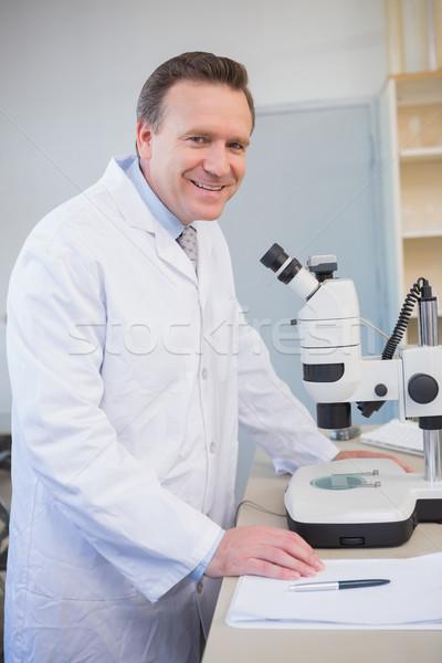 улыбаясь ученого образец микроскоп лаборатория Сток-фото © wavebreak_media