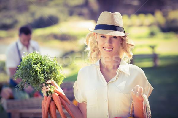 Femme blonde carottes portrait homme Photo stock © wavebreak_media