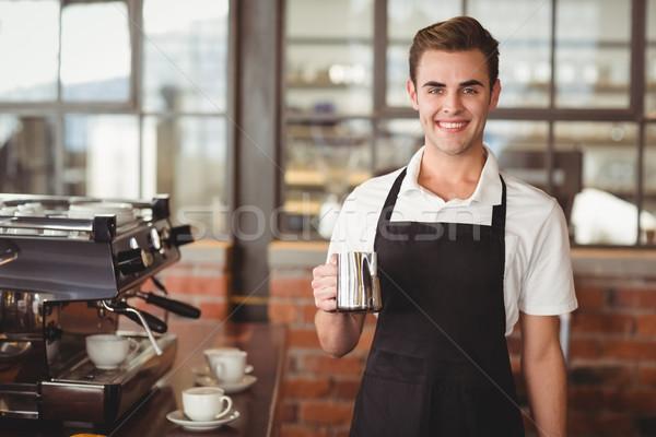 Sorridere barista brocca latte ritratto Foto d'archivio © wavebreak_media