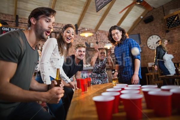 молодые друзей пива игры ресторан Сток-фото © wavebreak_media