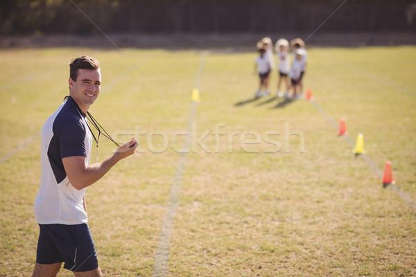 Portrait of coach holding stopwatch in park Stock photo © wavebreak_media