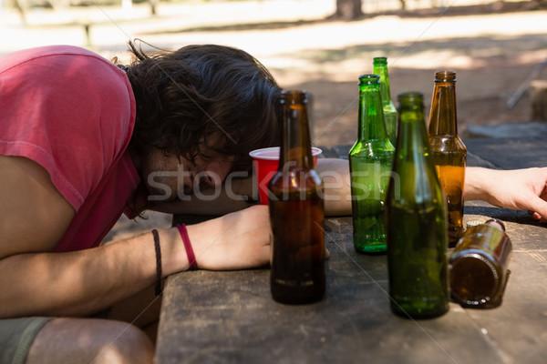 Bêbado homem tabela vidro Foto stock © wavebreak_media