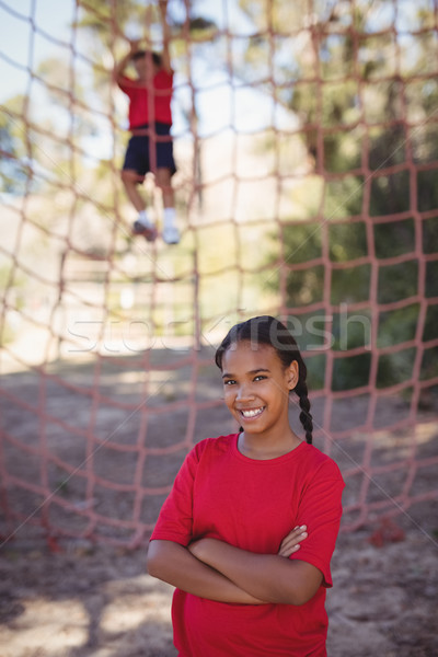 Portrait of girl standing with arms crossed during obstacle course Stock photo © wavebreak_media