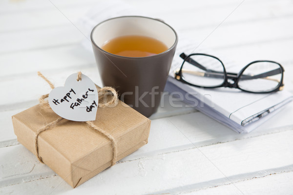 High angle view of coffee cup with fathers day gift Stock photo © wavebreak_media
