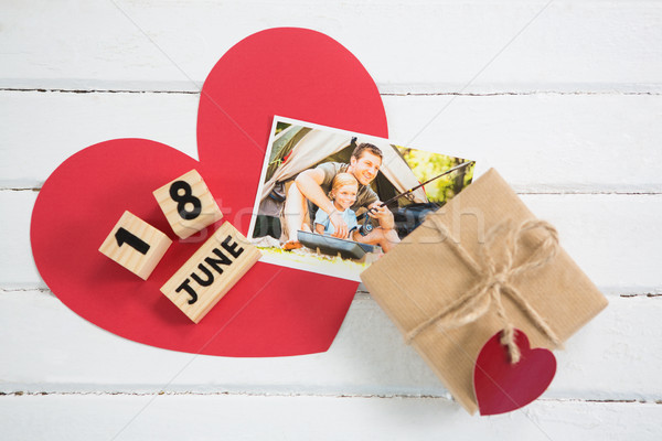 Overhead view of photograph with gift box and calender on table Stock photo © wavebreak_media