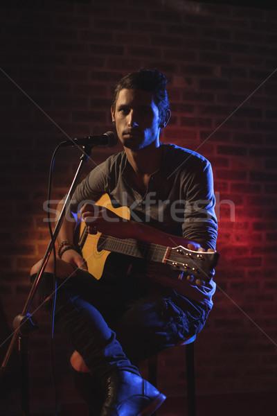 Confident male singer performing in nightclub Stock photo © wavebreak_media