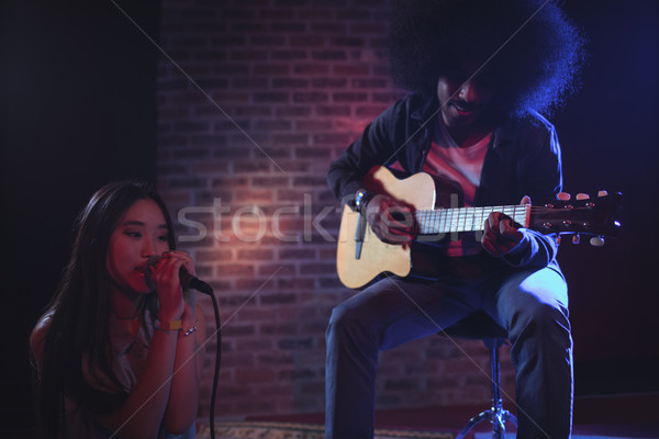 Female singer with male guitarist nightclub Stock photo © wavebreak_media