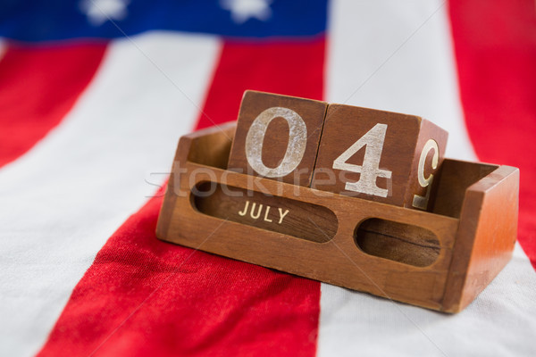 Date blocks on American flag with 4th july theme Stock photo © wavebreak_media