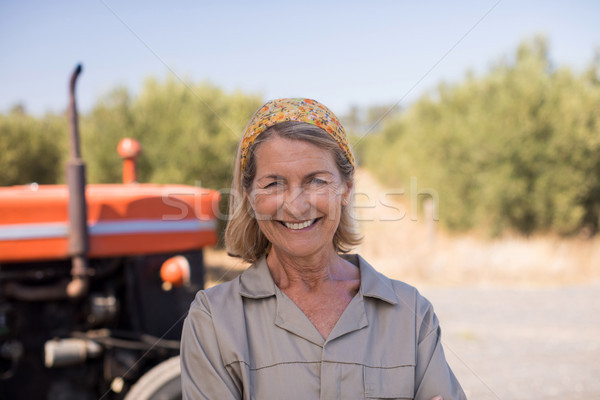Portrait of happy woman standing against tractor in olive farm Stock photo © wavebreak_media