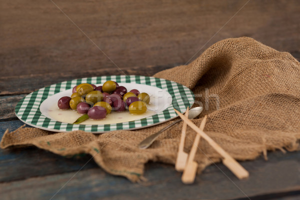 High angle view of black and green olives served in plate Stock photo © wavebreak_media
