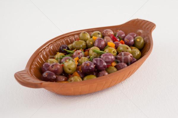Close up of olives served in bowl Stock photo © wavebreak_media