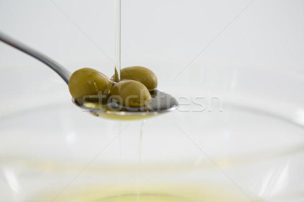 Green olive oil being poured in spoon Stock photo © wavebreak_media