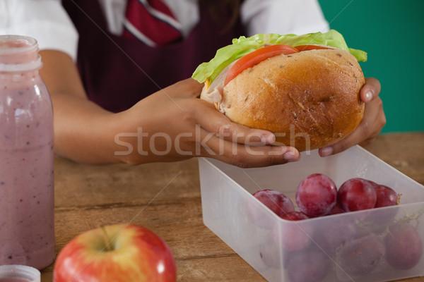 Schoolgirl having sandwich Stock photo © wavebreak_media