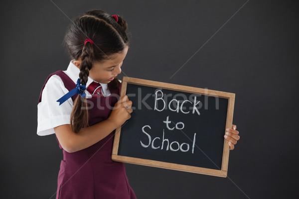 écolière texte tableau noir classe enfant Photo stock © wavebreak_media