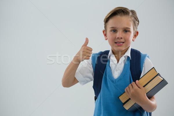 Portrait of school boy showing thumbs up Stock photo © wavebreak_media
