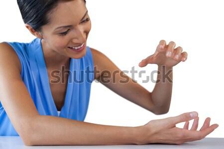 Heureux femme d'affaires quelque chose séance table Photo stock © wavebreak_media