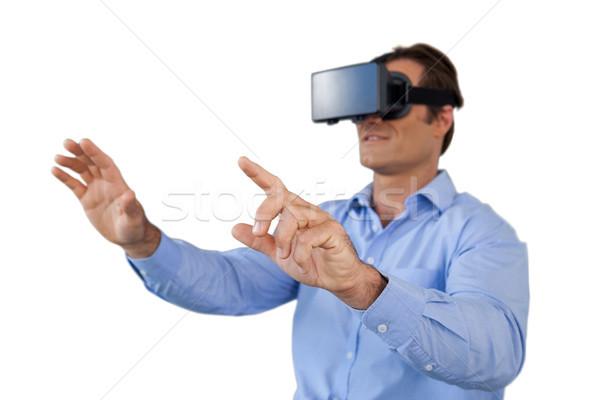 Mature businessman using vr glasses Stock photo © wavebreak_media