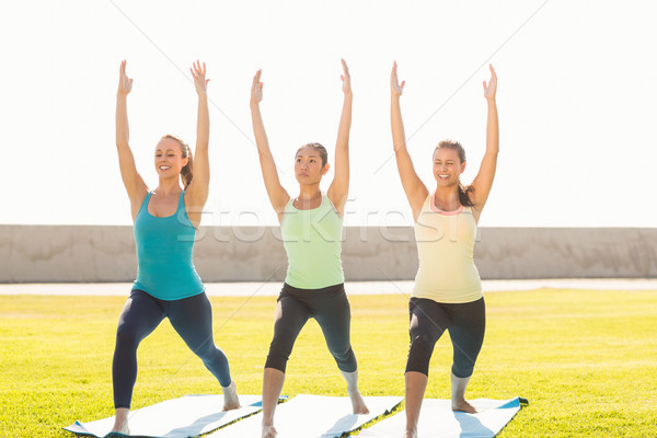 Smiling sporty women doing yoga together Stock photo © wavebreak_media