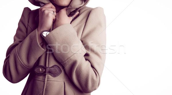 Attractive woman wearing a warm coat with hood raised Stock photo © wavebreak_media