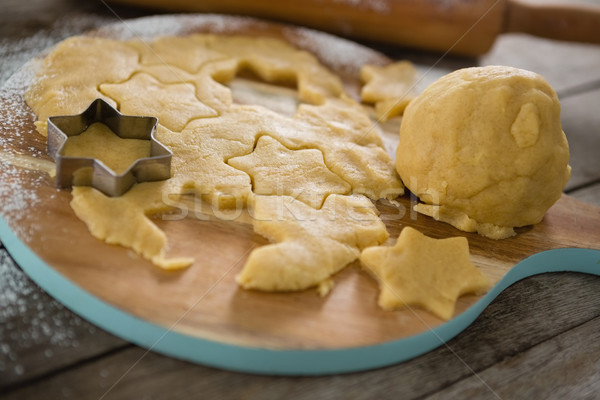 Close up of dough on cutting board with star shape cutter Stock photo © wavebreak_media