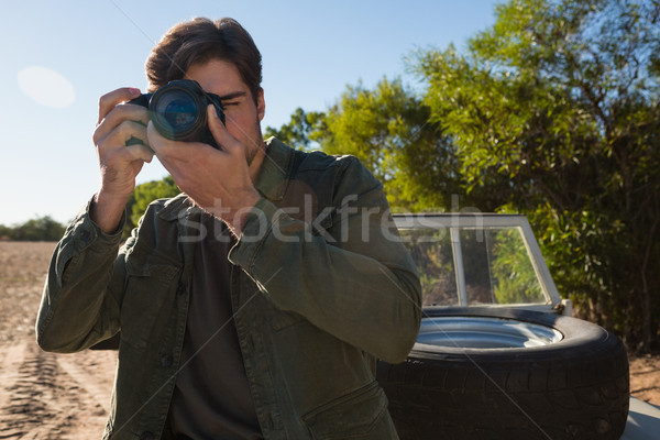 Young man photographing by vehicle Stock photo © wavebreak_media