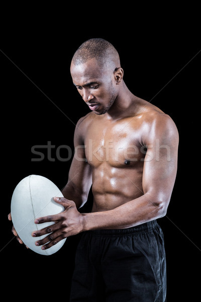 Concentré torse nu athlète regardant vers le bas rugby Photo stock © wavebreak_media