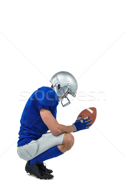 Profile view of American football player in attack stance Stock photo © wavebreak_media