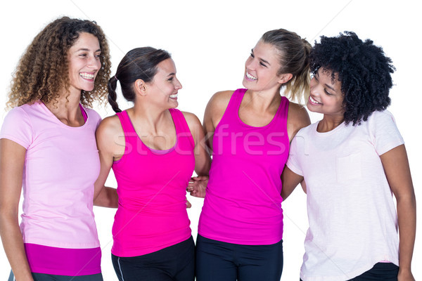 Smiling group of women with arms around  Stock photo © wavebreak_media