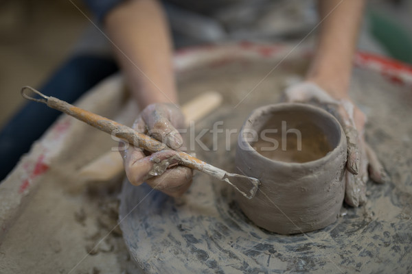 Female potter molding plate with hand tool Stock photo © wavebreak_media