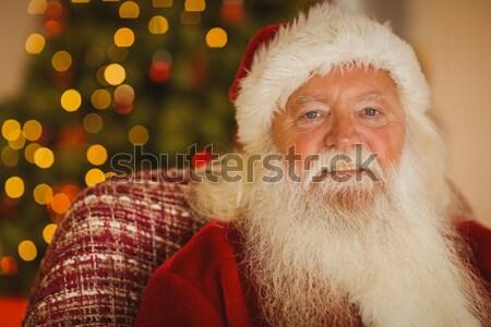 Santa claus keeping his finger on lips at home Stock photo © wavebreak_media