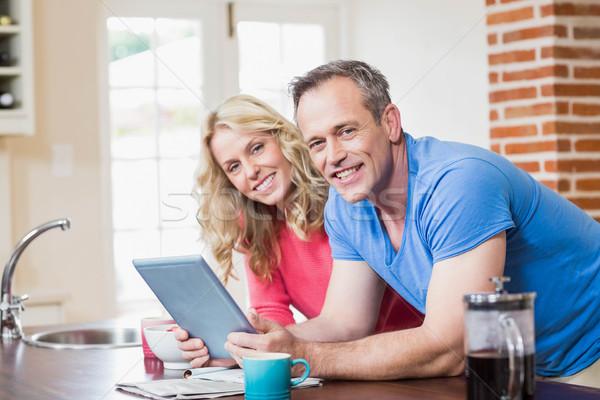 Cute couple using tablet Stock photo © wavebreak_media