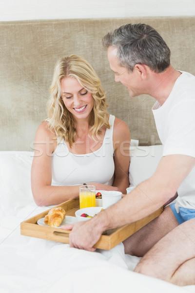 Sevimli çift kahvaltı yatak oda kadın Stok fotoğraf © wavebreak_media