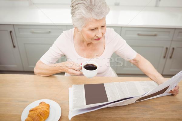 Senior woman reading a newspaper Stock photo © wavebreak_media